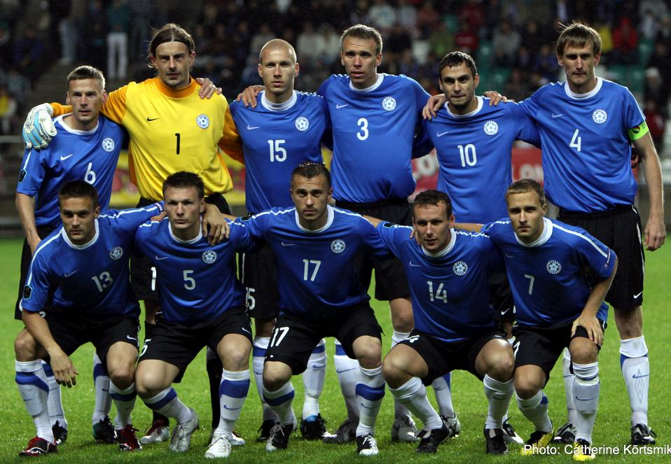Estonia-10-11-NIKE-home-kit-blue-black-white-pose.jpg