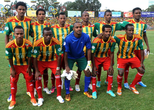 Ethiopia-12-adidas-home-kit-stripe-red-red-pose.jpg