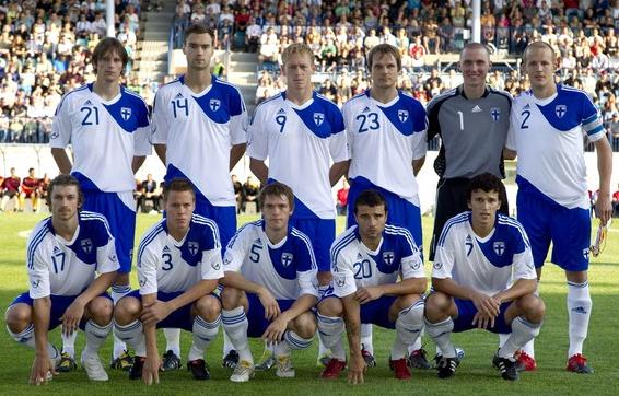 Finland-10-11-adidas-home-kit-white-blue-white-pose.JPG