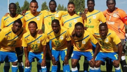 Gabon-11-PUMA-home-kit-yellow-blue-blue-line-up-with-OLAM.jpg