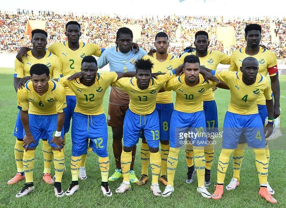 Gabon-2014-16-PUMA-home-kit-yellow-blue-yellow-line-up.jpg