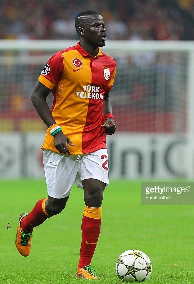 Galatasaray-2013-14-NIKE-home-kit-Emmanuel-Eboue.jpg