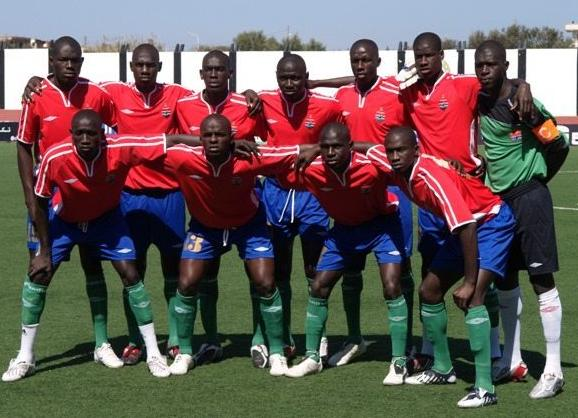 Gambia-09-UMBRO-uniform-red-blue-green-group.JPG