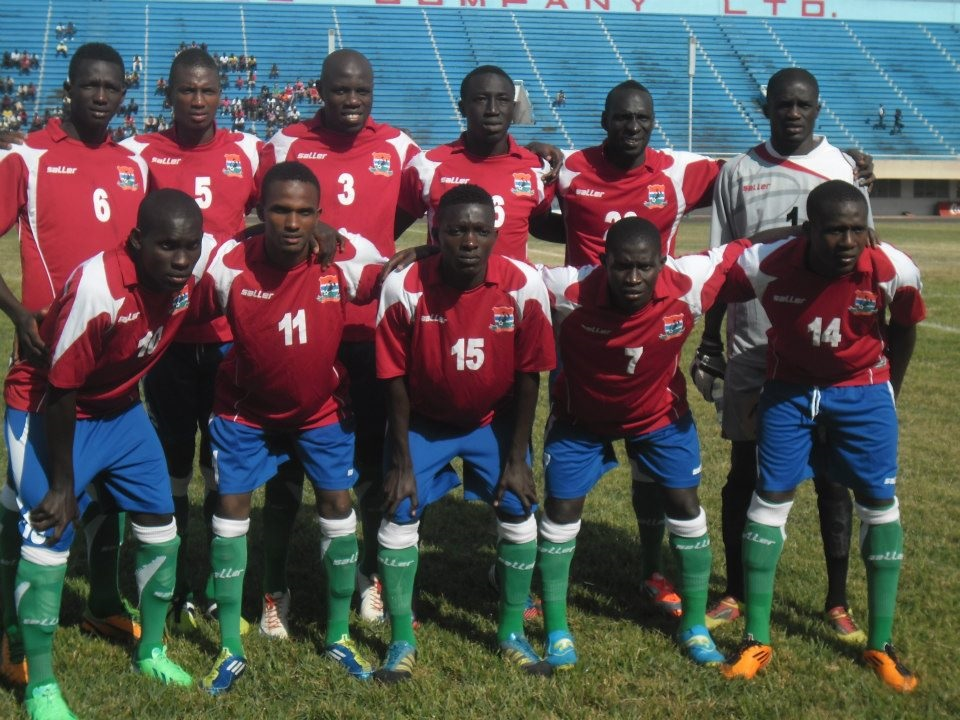 Gambia-09-saLLer-home-kit-red-blue-green-line-up.jpg
