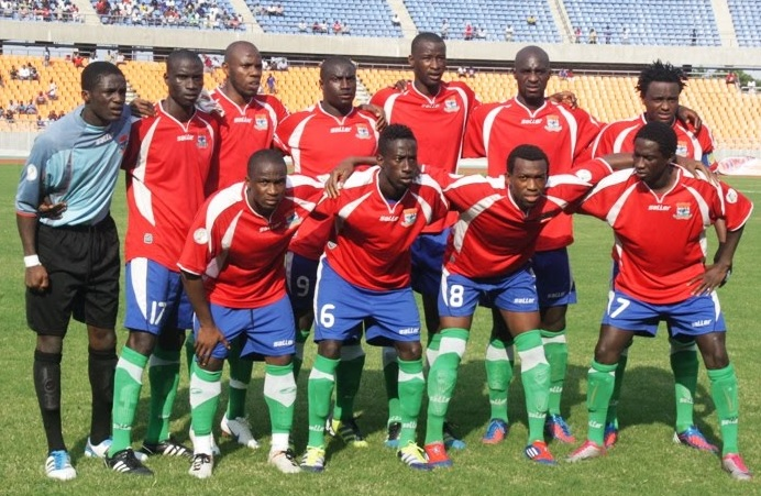 Gambia-12-saLLer-home-kit-red-blue-green-line-up.jpg