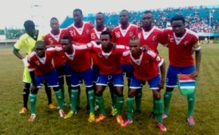 Gambia-13-adidas-home-kit-red-blue-green-line-up.jpg