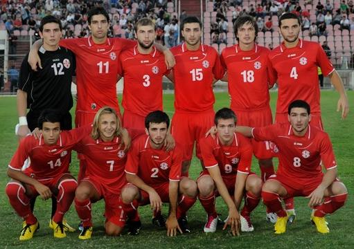 Georgia-10-11-JAKO-home-kit-red-red-red-line up.JPG