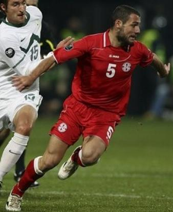 Georgia-10-11-JAKO-home-kit-red-red-red.JPG