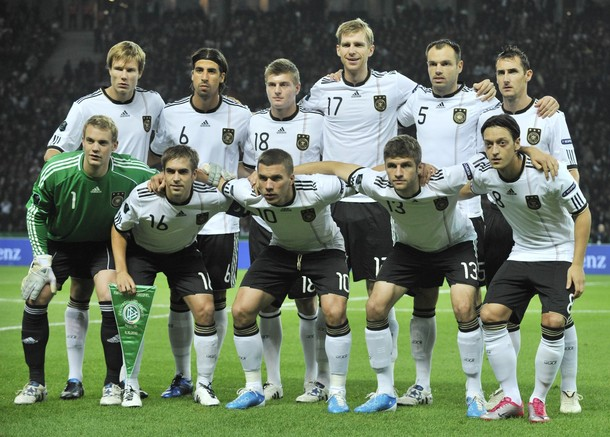 Germany-10-11-adidas-euro-qualifying-home-kit-white-black-white-pose.jpg