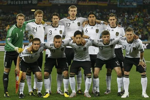 Germany-10-adidas-World Cup-home-kit-white-black-white-pose.jpg