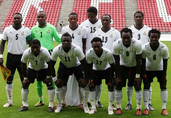 Ghana-08-09-PUMA-home-uniform-white-black-white-pose.JPG
