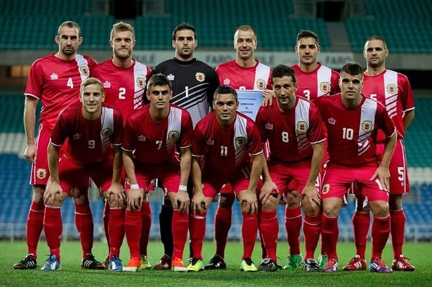 Gibraltar-13-14-Admiral-home-kit-red-red-red-line-up.jpg