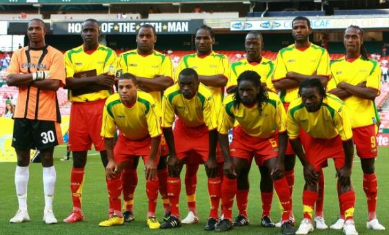 Grenada-09-unknown-home-kit-yellow-red-red-pose.JPG