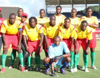 Grenada-10-Joma-home-kit-yellow-red-green-pose.JPG