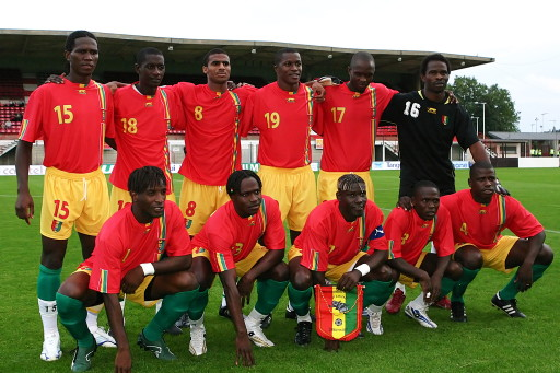 Guinea-07-AIRNESS-home-kit-red-yellow-green-pose.jpg