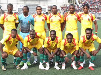 Guinea-08-09-AIRNESS-home-kit-yellow-yellow-green-line up.jpg