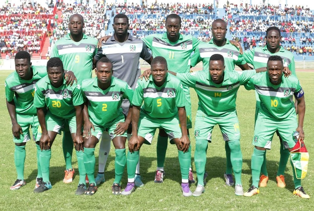 Guinea-Bissau-2015-16-macron-away-kit-green-green-green-line-up.jpg