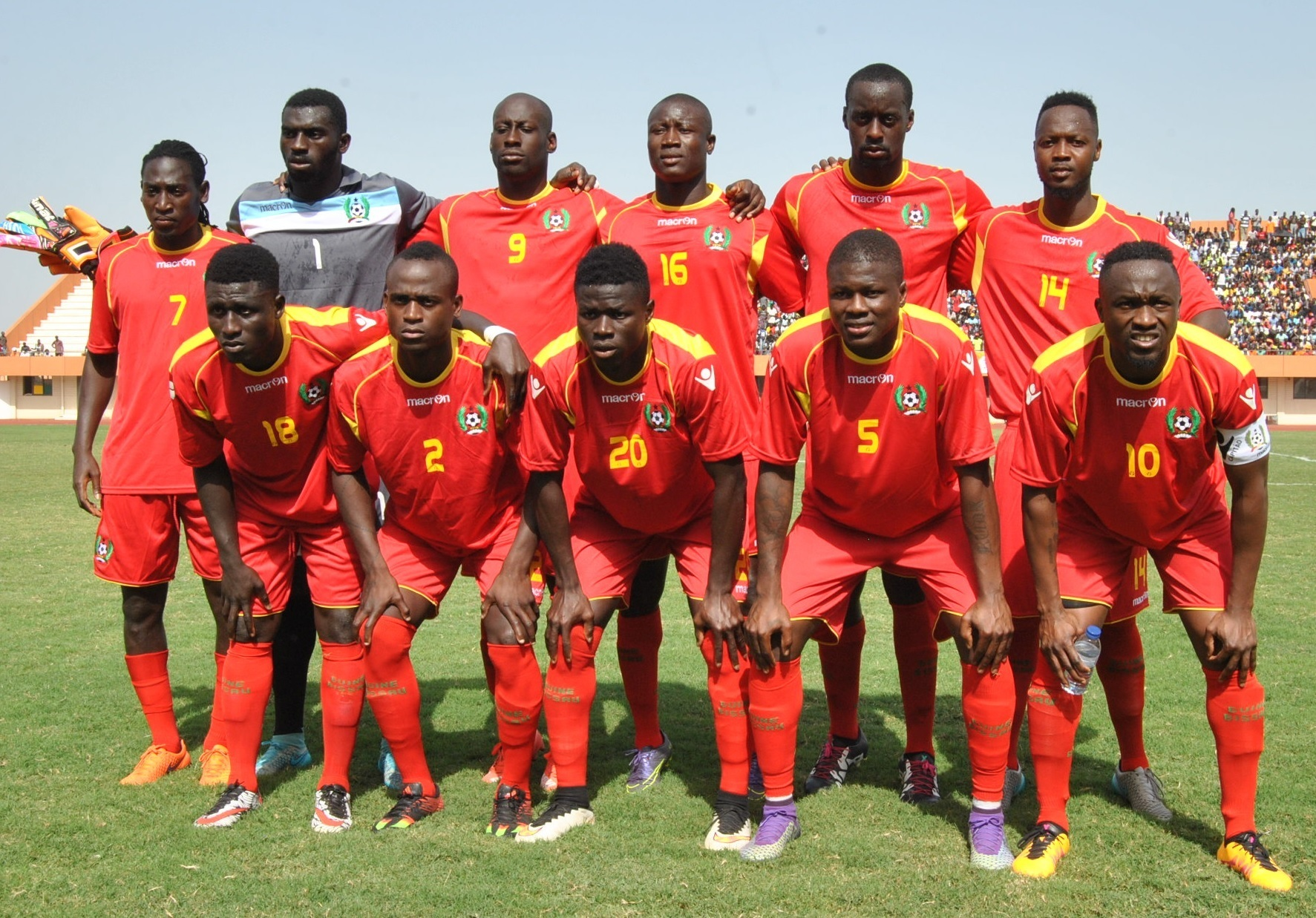 Guinea-Bissau-2015-16-macron-home-kit-red-red-red-line-up.jpg
