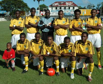Guyana-06-07-adidas-away-kit-yellow-white-yellow-pose.JPG
