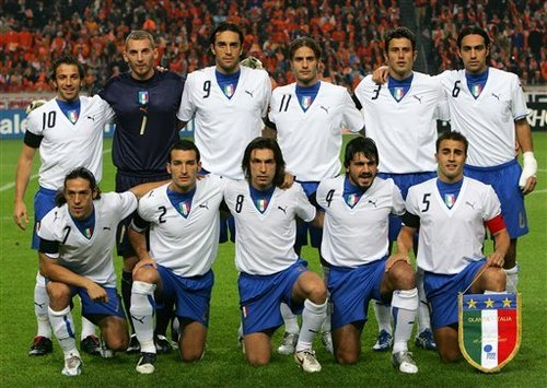 Italy-06-07-PUMA-away-uniform-white-blue-white-pose.JPG
