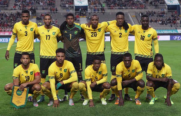 Jamaica-2015-romai-home-kit-yellow-black-yellow-line-up.jpg