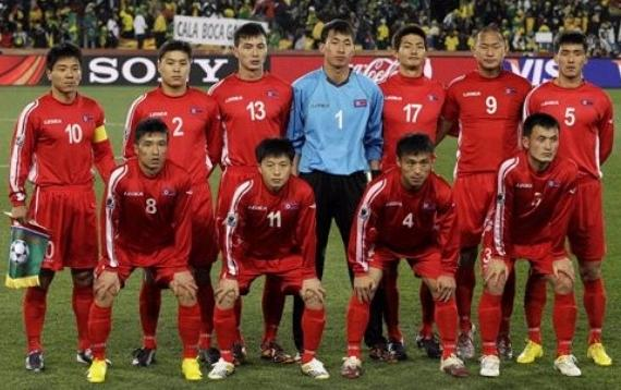 Korea DPR-10-LEGEA-away-kit-red-red-red-pose.JPG