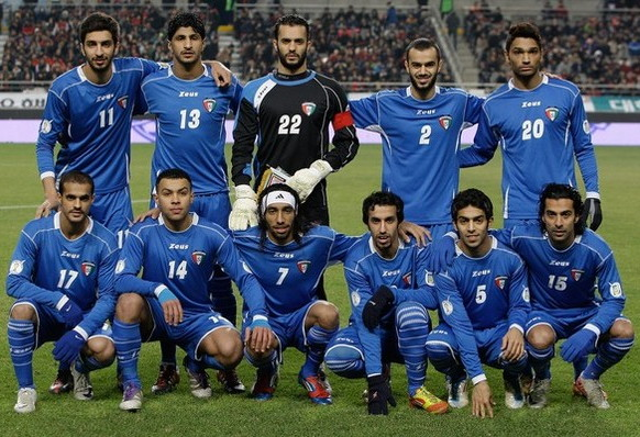 Kuwait-12-Zeus-home-kit-blue-blue-blue-line-up.jpg