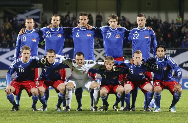 Liechtenstein-10-11-adidas-home-kit-blue-red-blue-line-up.jpg
