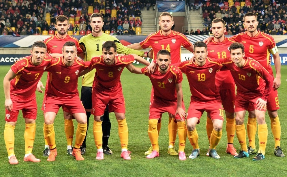 Macedonia-2014-15-JAKO-home-kit-red-red-yellow-line-up.jpg