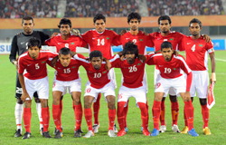 Maldives-10-11-NIKE-home-kit-red-white-red-pose.JPG