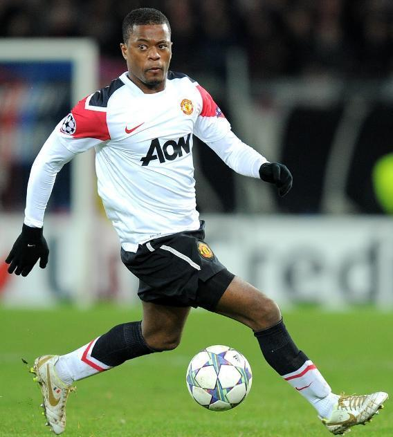 Manchester-United-11-12-NIKE-third-kit-white-black-white-Patrice-Evra.jpg
