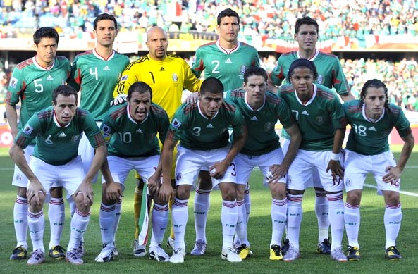 Mexico-10-adidas-World Cup-home-kit-green-white-white-pose.JPG