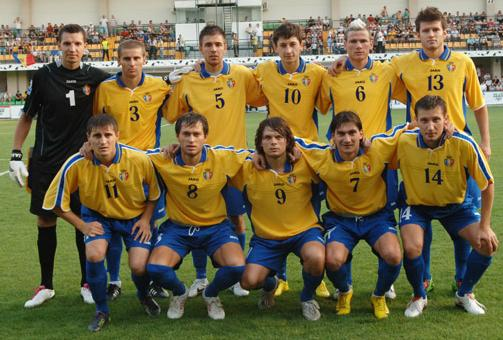 Moldova-10-11-JAKO-away-kit-yellow-blue-blue-pose.JPG