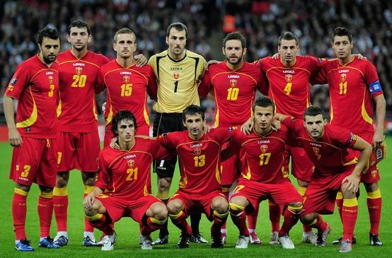 Montenegro-10-11-LEGEA-home-kit-red-red-red-line-up.JPG