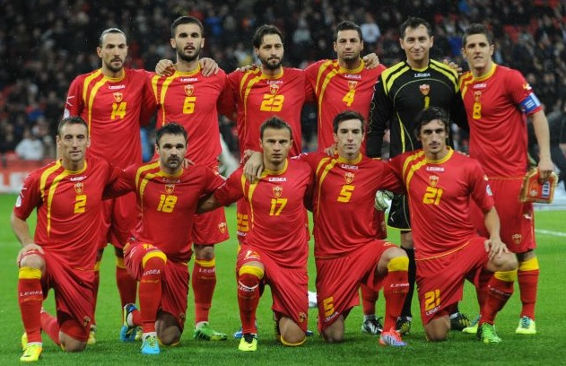 Montenegro-12-13-LEGEA-home-kit-red-red-red-line-up.jpg