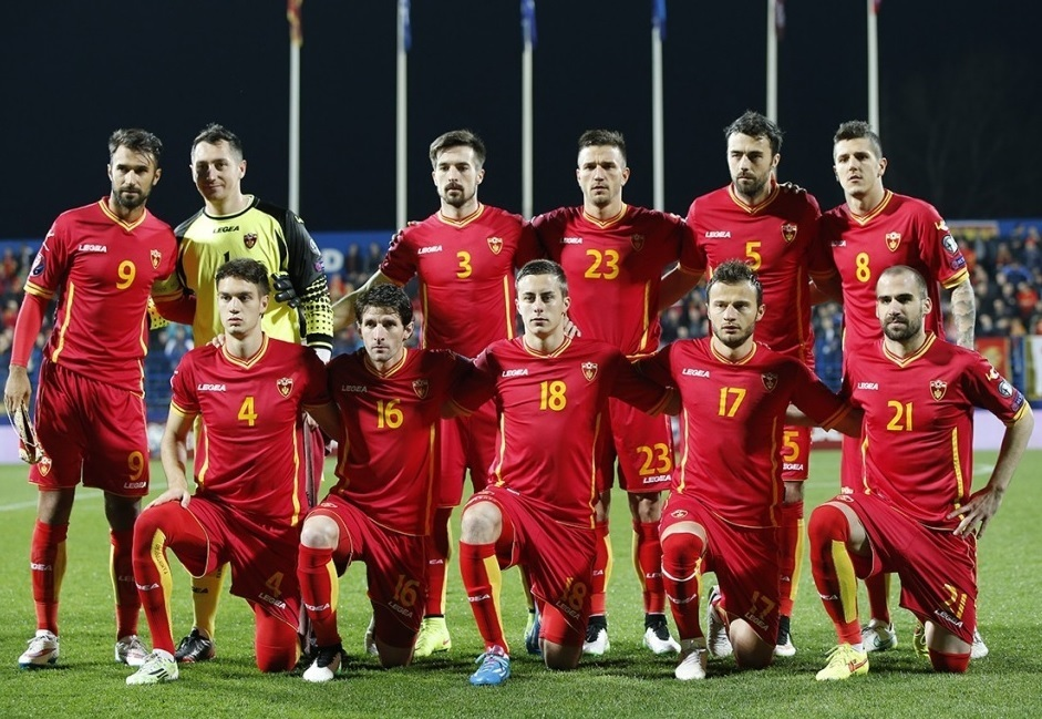 Montenegro-2014-15-LEGEA-home-kit-red-red-red-line-up.jpg