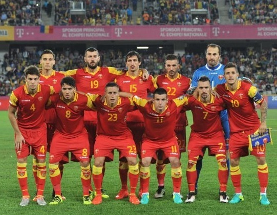 Montenegro-2016-17-LEGEA-home-kit-red-red-red-line-up.jpg