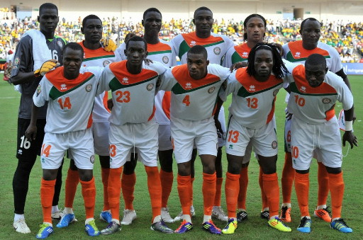 Niger-12-errea-away-kit-white-white-orange-line-up.jpg