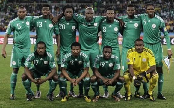Nigeria-10-11-adidas-home-kit-green-green-green-pose.JPG
