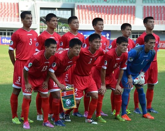 North-Korea-12-14-LEGEA-home-kit-red-red-red-line-up.jpg