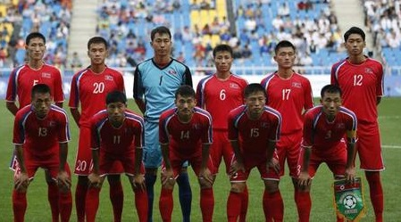 North-Korea-2014-no-name-home-kit-red-red-red-line-up.jpg