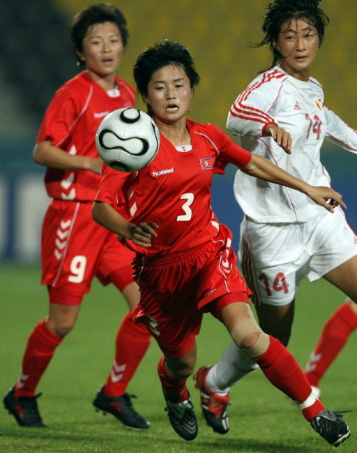 North Korea-06-07-hummel-wome-home-kit-red-red-red.jpg