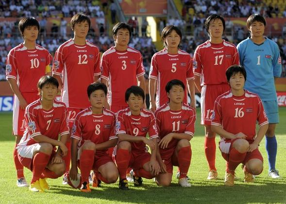 North Korea-11-12-LEGEA-women-world-cup-home-red-red-red-line-up.JPG