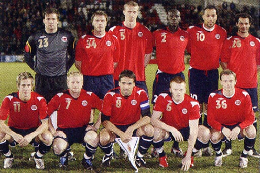 Norway-07-08-UMBRO-red-navy-navy-group.JPG