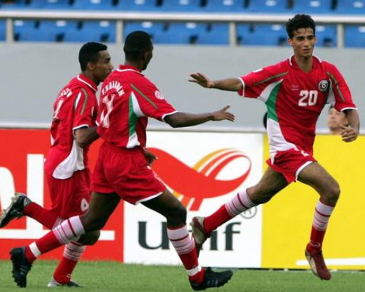 Oman-04-GRND SPORT-asian-cup-home-kit-red-red-red-line-up.jpg