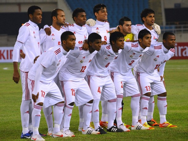 Oman-12-adidas-away-kit-white-white-white-line-up.jpg