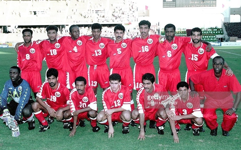 Oman-1996-PUMA-home-kit-red-red-red-line-up.jpg