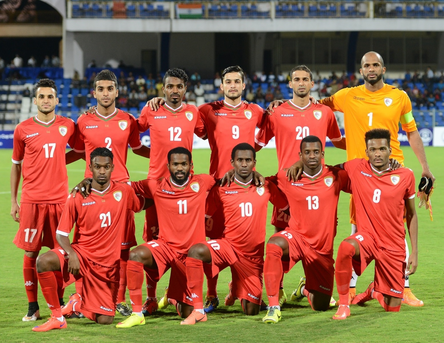 Oman-2015-Kappa-world-cup-qualifier-home-kit-red-red-red-line-up.jpg