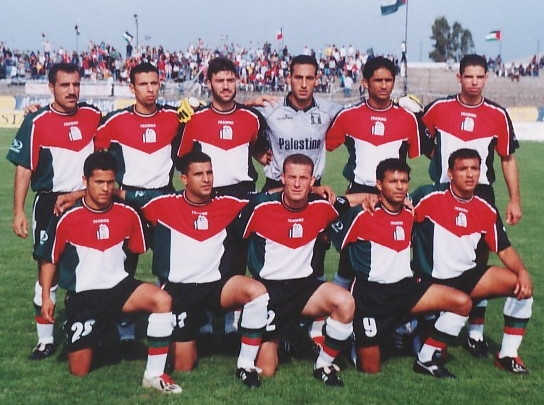 Palestine-02-03-TRAINING-home-kit-red-black-white-line-up.jpg