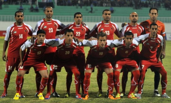 Palestine-12-uhlsport-home-kit-red-red-red-line-up.jpg